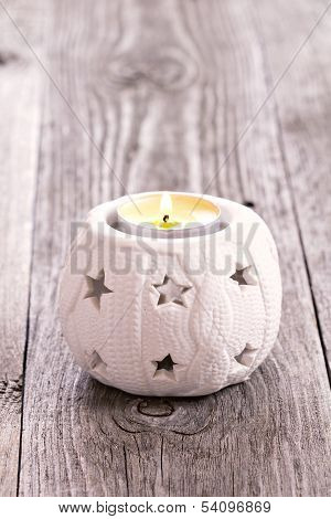 Candle lighting in a white christmas candleholder