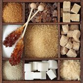 stock photo of sugar cube  - Various kinds of sugar in wooden box - JPG