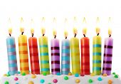 image of ten  - Ten birthday candles on white background - JPG