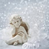 stock photo of sad christmas  - Angel statue on silver background - JPG
