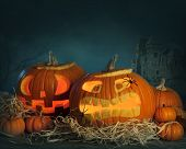 pic of funny ghost  - Halloween pumpkins on a wooden desk at night - JPG