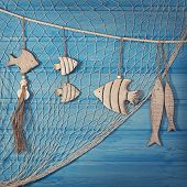 stock photo of fishnet  - Marine life decoration and on blue shabby background - JPG