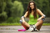 pic of inline skating  - Happy young girl enjoying roller skating rollerblading on inline skates sport in park - JPG