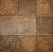 stock photo of linoleum  - Brown tile effect flooring close up background - JPG
