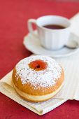 Fresh Donut On A Napkin With A Cup Of Tea
