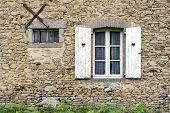 picture of farmhouse  - French stone farmhouse window with white shutters and hearts - JPG
