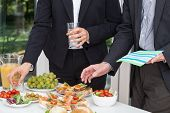 stock photo of buffet lunch  - Business party and the buffet on the open air - JPG