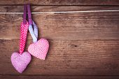 foto of lovable  - Crochet valentine hearts handing on the rope - JPG
