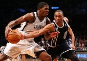 BROOKLYN, NY-DEC 4: Brooklyn Nets guard Joe Johnson (L) drives to the net as Oklahoma City Thunder p