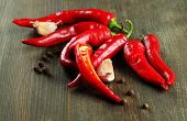 stock photo of fiery  - Red hot chili peppers  and garlic - JPG