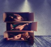 stock photo of contortionist  - a woman in a box - JPG