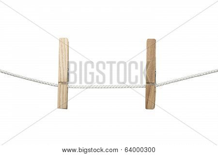 Two Clothespins On A String, Isolated On White