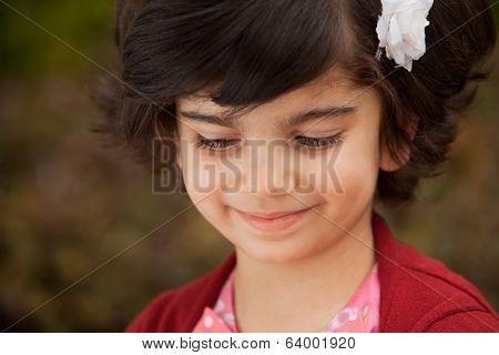 Portrait Of Smiling Little Caucasian Girl