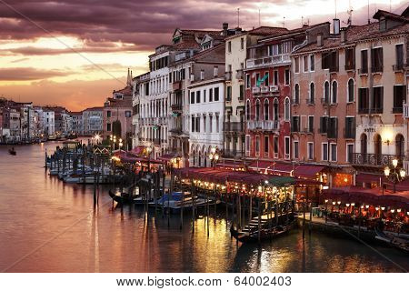 Venice Grand Canal gondolas, hotels and restaurants at sunset from the Rialto Bridge