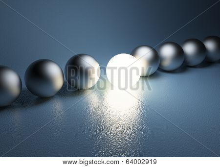 Bright Glowing Sphere In A Row. Leadership Concept