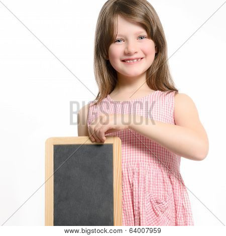 Cute Girl With A Toothy Grin Holding A Slate