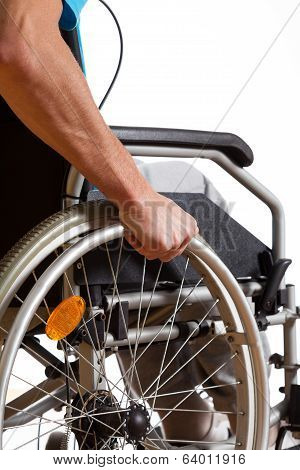 Man Sitting In Wheelchair