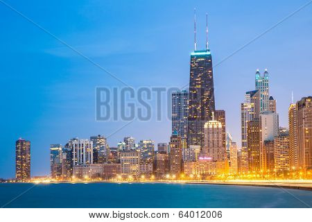 City of Chicago downtown and Lake Michigan at dusk.