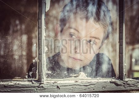 Boy looking out a window