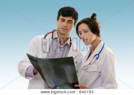 Two Doctors Conferring Over X-ray Results