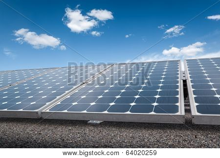 Solar Panels Over Blue Sky