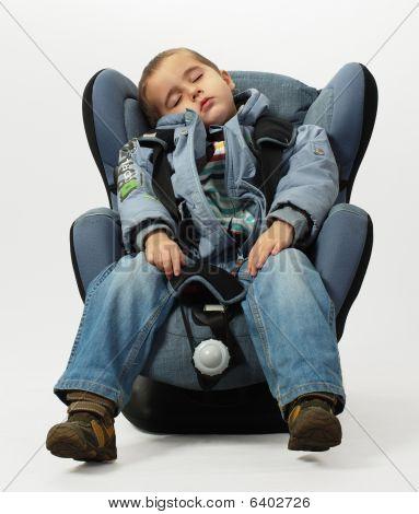 Boy Sleeps In Safe Auto Chair
