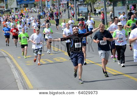 BELGRADE, SERBIA - APRIL 27: A group of marathon competitors during the 27th Belgrade Marathon on April 27, 2014 in Belgrade, Serbia