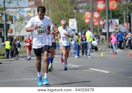 BELGRADE, SERBIA - APRIL 27: A group of marathon competitors during the 27th Belgrade Marathon on April 27, 2014 in Belgrade, Serbia