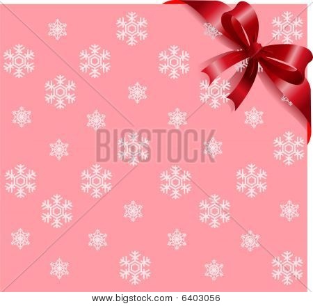 Red ribbon on pink snowflakes background