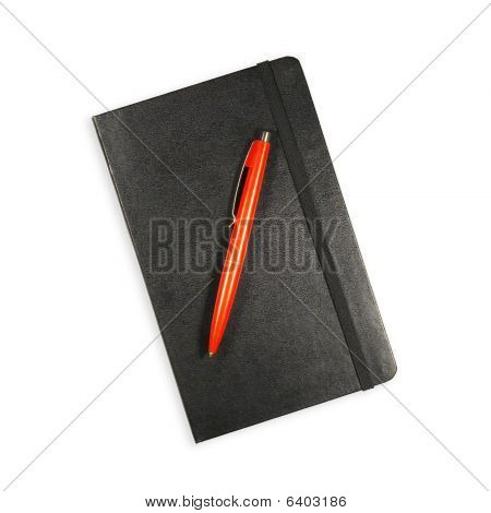 Black Notebook And Red Pen On White