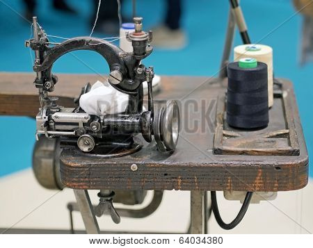 Old Sewing Machine On Wooden Base