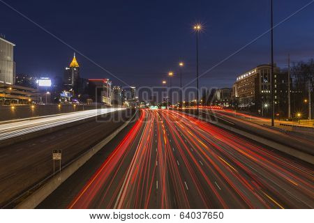 Atlanta, Georgia, USA - February 15, 2014:  Night freeway traffic in midtown Atlanta speeding towards downtown towers.