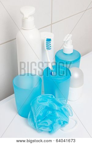Hygiene Supplies Over Tiled Wall In Bathroom