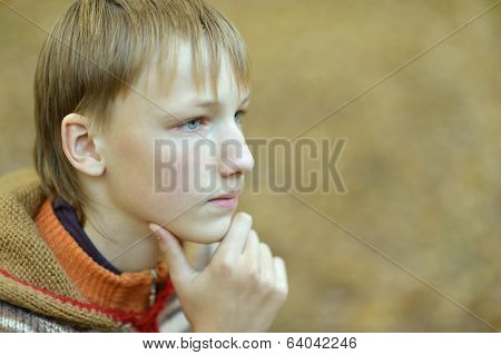 Sad little boy outdoors