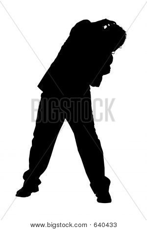 Silhouette Of Cowering Business Man