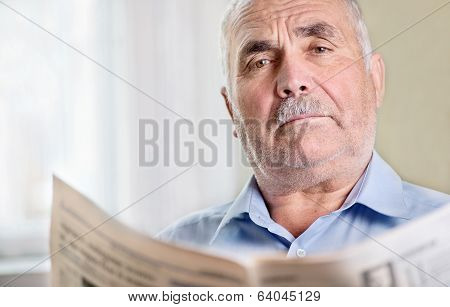 Senior Man Relaxing Reading A Newspaper