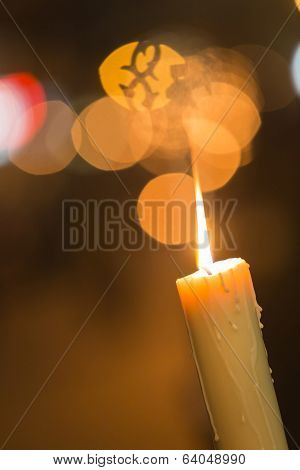 Candle Light With Light Bokeh In The Background