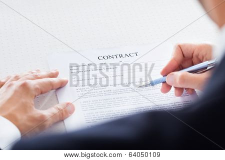Businessman Looking At Contract Paper