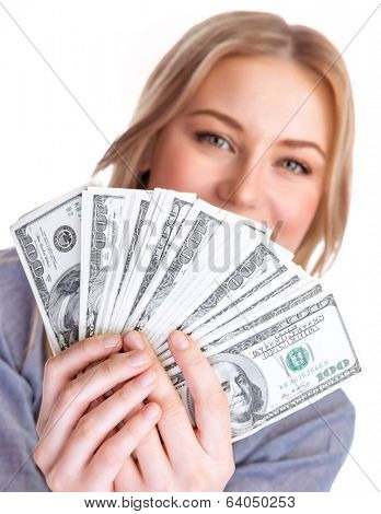 Closeup portrait of young lady holding in hands and showing a wad of american dollars, isolated on white background, business and finance concept