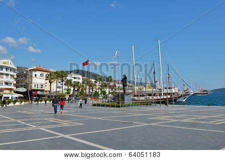 MARMARIS, TURKEY - APRIL 1, 2014: People near the monument to Ataturk on the embankment. The founder of Republic of Turkey still is esteemed in the country today