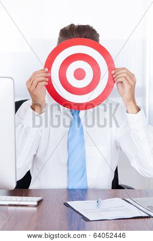 Businessman Holding Dartboard