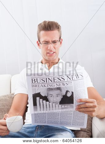 Reading Newspaper With The Headline Breaking News