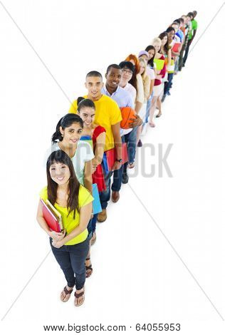Multi-ethnic group of student holding the book standing in line