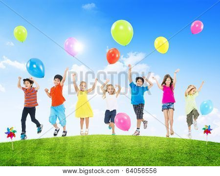 Happy Multi-Ethnic Children Outdoors with Arms Raised