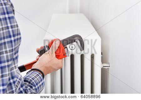 Plumber Fixing Radiator