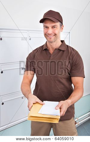 Postman Holding Letters
