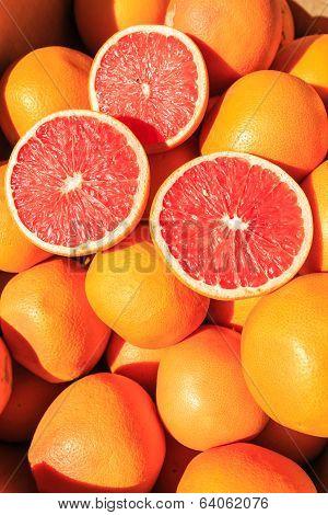 Sliced Oranges On A Pile Of Oranges