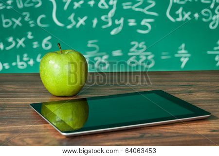 Didital Tablet And Apple On The Desk