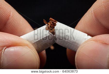 Hand Breaking Cigarette