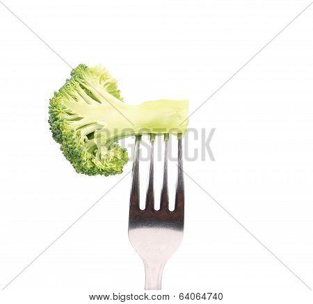 Fresh broccoli on a fork.